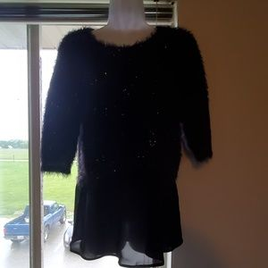 Short sleeve sweater with sheer bottom.